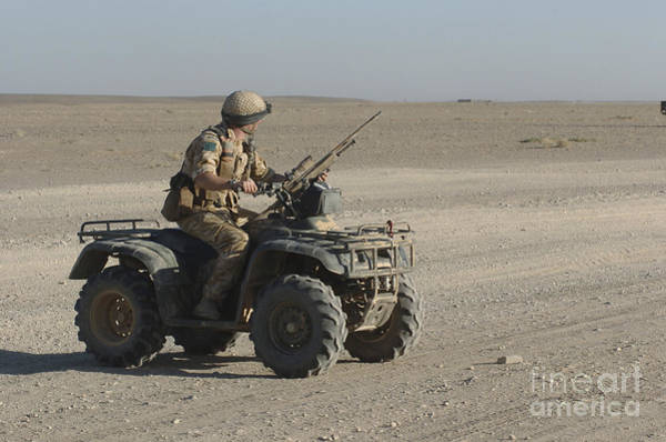 Four Wheeler Photograph - A British Army Soldier Provides by Andrew Chittock