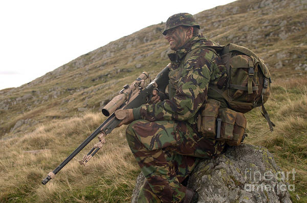 Sharpshooter Wall Art - Photograph - A British Soldier Armed With A Sniper by Andrew Chittock