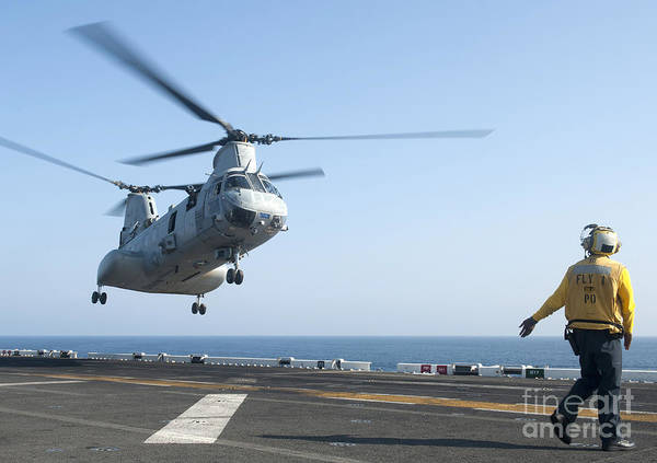 Flight Deck Photograph - A Ch-46e Sea Knight Helicopter Prepares by Stocktrek Images