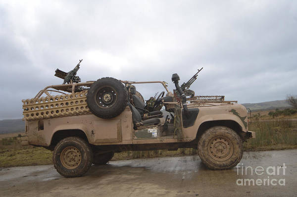 Photograph - A Pink Panther Land Rover by Andrew Chittock