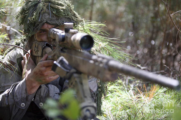 Sharpshooter Wall Art - Photograph - A Sniper Sights In On A Target by Stocktrek Images