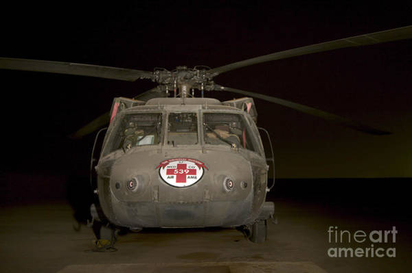 Utility Helicopter Photograph - A Uh-60 Blackhawk Medivac Helicopter by Terry Moore