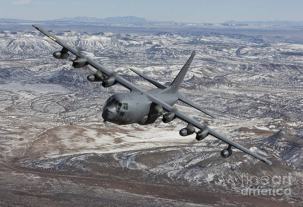 Aerial Combat Photograph - An Mc-130 Aircraft Manuevers by HIGH-G Productions