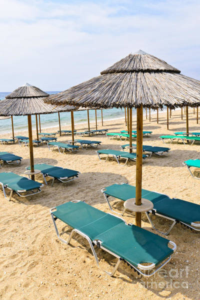 Photograph - Beach Umbrellas On Sandy Seashore by Elena Elisseeva