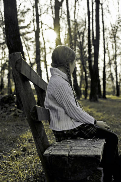 Wall Art - Photograph - Girl Sitting On A Wooden Bench In The Forest Against The Light by Joana Kruse