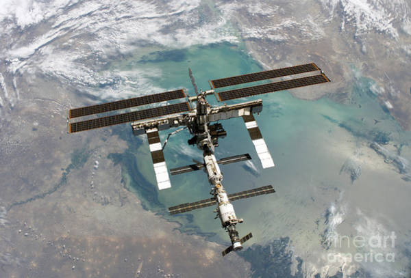 Return To Earth Photograph - International Space Station by Nasa