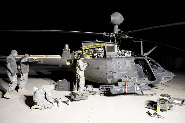 Kiowa Photograph - Maintenance Crew Works On Servicing by Terry Moore