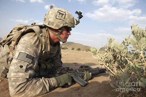 Battleground Photograph - U.s Army Specialist Provides Security by Stocktrek Images