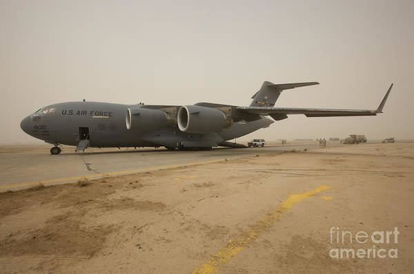 Taxiway Wall Art - Photograph - A C-17 Globemaster IIi Sits by Terry Moore