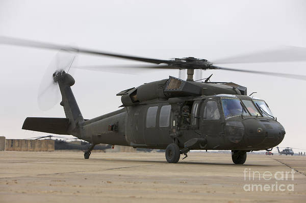 Utility Helicopter Photograph - A Uh-60 Black Hawk Taxis by Terry Moore