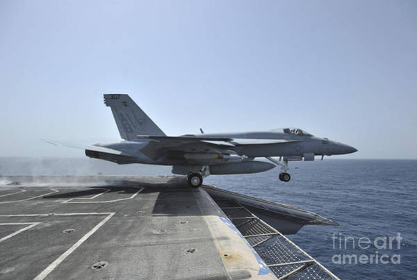 Flight Deck Photograph - An Fa-18e Super Hornet Launches by Stocktrek Images