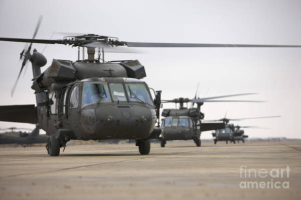 Taxiway Wall Art - Photograph - Uh-60 Black Hawks Taxis by Terry Moore