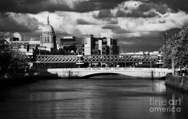 Wall Art - Photograph - View Of The River Liffey In Dublin City Centre Republic Of Ireland by Joe Fox