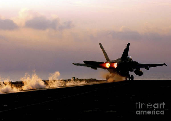 Flight Deck Photograph - An Fa-18a+ Hornet Launches by Stocktrek Images