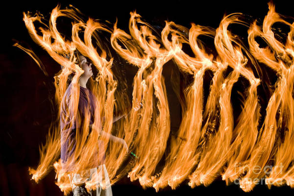 Juggler Photograph - Juggling Fire by Ted Kinsman