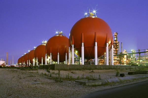 Liquify Photograph - Oil Refinery Storage Tanks by Paul Rapson