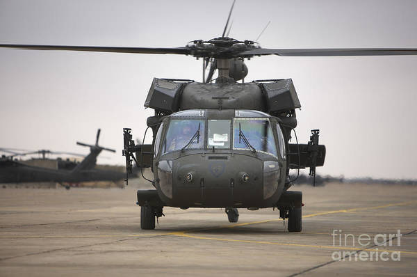 Taxiway Wall Art - Photograph - A Uh-60 Black Hawk Taxis by Terry Moore