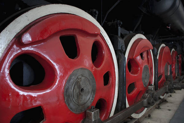 Wall Art - Photograph - Close Up Of The Rows Of Steel Wheels by Guang Ho Zhu