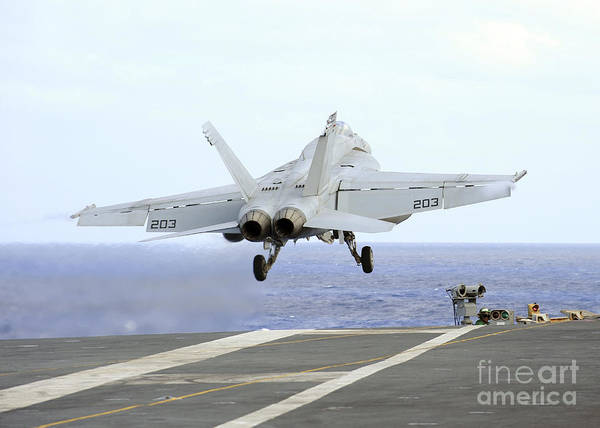 Uss George Washington Wall Art - Photograph - An Fa-18e Super Hornet Launches by Stocktrek Images