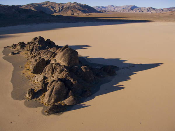Racetrack Playa Photograph - A 73-foot-high Outcrop Breaks The Flat by Michael Melford