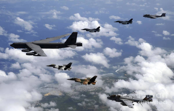 Prowler Photograph - A B-52 Stratofortress Leads A Formation by Stocktrek Images
