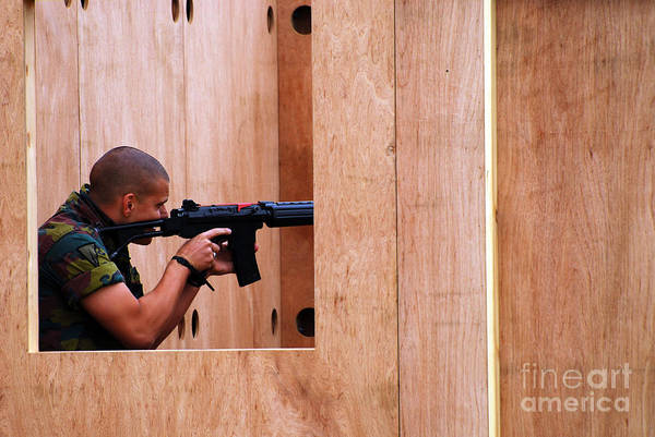 Fnc Photograph - A Belgian Soldier Trying Out A Shooting by Luc De Jaeger