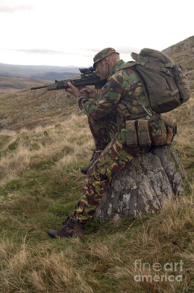 Sharpshooter Wall Art - Photograph - A British Soldier Armed With A Sa80 by Andrew Chittock