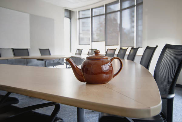 Wall Art - Photograph - A Brown China Teapot On Boardroom Table by Marlene Ford