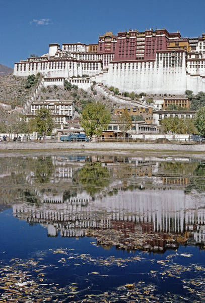 Wall Art - Photograph - A Buddhist Palace Is Reflected by Gordon Wiltsie