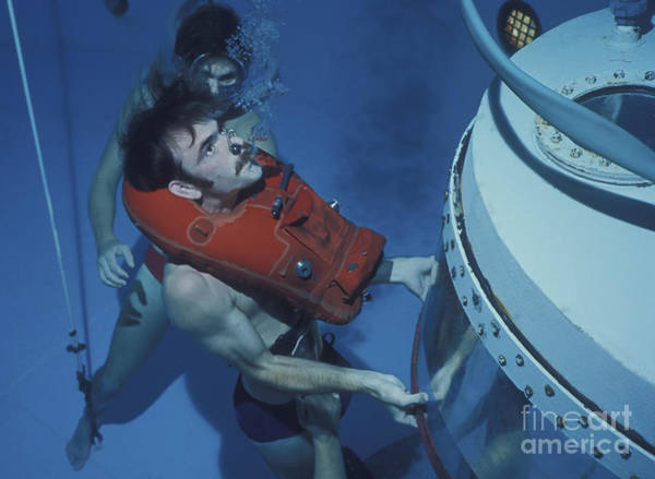 Diving Bell Photograph - A Buoyant Ascent Training Student Holds by Michael Wood