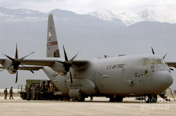 Airbase Photograph - A C-130j Hercules Takes On 25k-pounds by Stocktrek Images