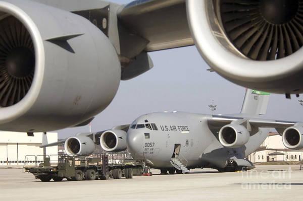 Photograph - A C-17 Globemaster IIi Awaits Loading by Stocktrek Images