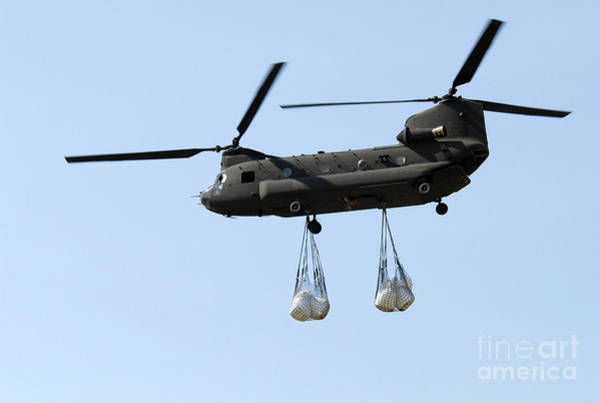 National Guard Photograph - A Ch-47 Chinook Carrying Sandbags by Stocktrek Images