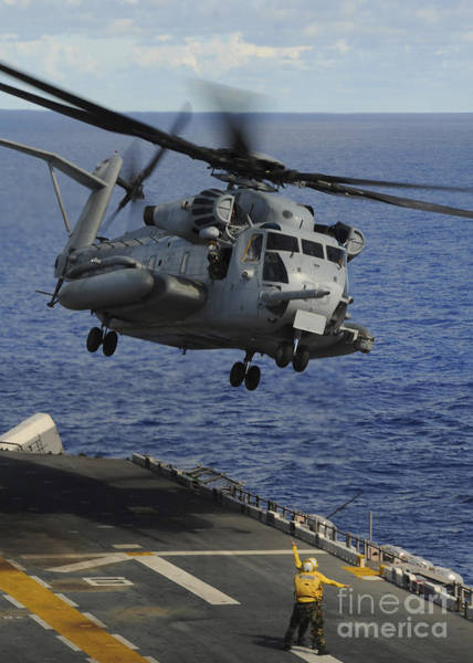 Amphibious Assault Ship Wall Art - Photograph - A Ch-53e Sea Stallion Helicopter Takes by Stocktrek Images