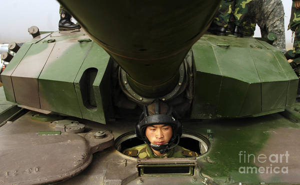 Photograph - A Chinese Tanker Soldier by Stocktrek Images