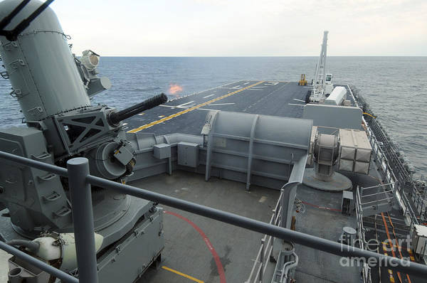 Gunfire Photograph - A Close-in Weapons System Fires Aboard by Stocktrek Images