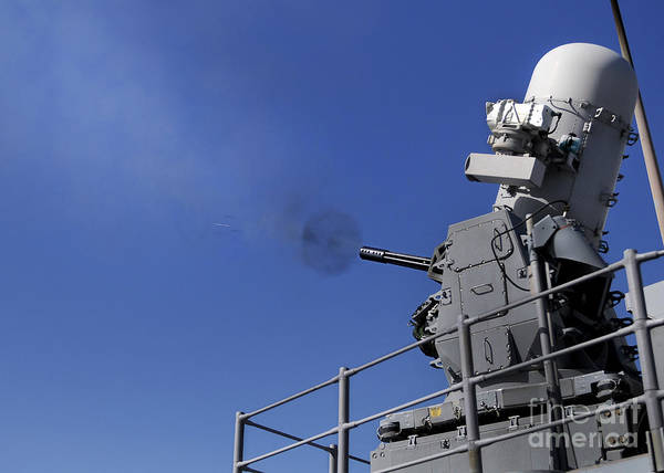 Gunfire Photograph - A Close-in Weapons System Is Fired by Stocktrek Images