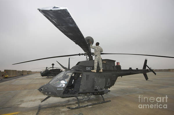 Kiowa Photograph - A Crew Chief Peforms Maintenance by Terry Moore