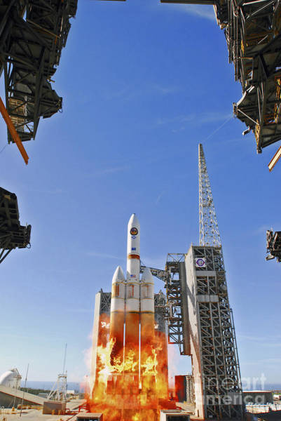 Delta Iv Photograph - A Delta Iv Heavy Launch Vehicle by Stocktrek Images