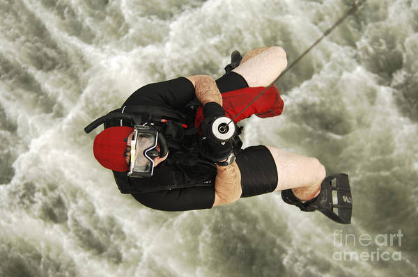 Photograph - A Diver Is Hoisted Aboard An Sh-60f by Stocktrek Images