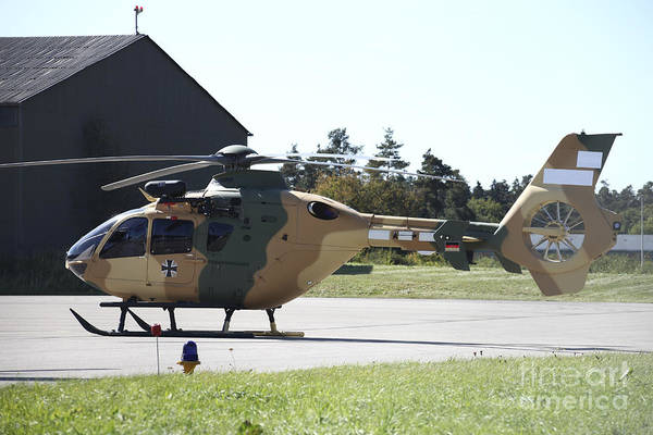 Utility Aircraft Photograph - A Eurocopter Ec-635 Helicopter by Timm Ziegenthaler