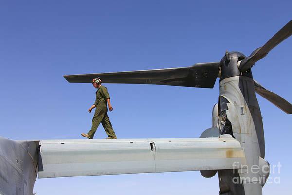 Mv-22 Photograph - A Flightline Mechanic Takes A Look by Stocktrek Images