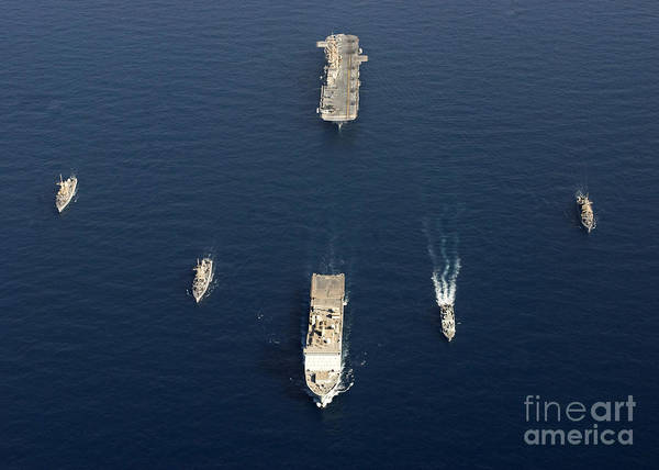 Amphibious Assault Ship Wall Art - Photograph - A Formation Of Ships At Sea by Stocktrek Images