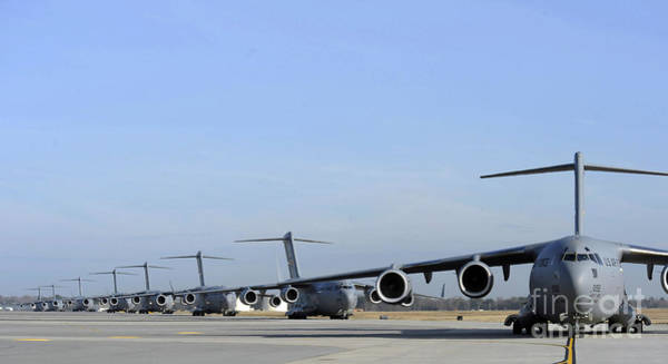C-17 Photograph - A Formation Of U.s. Air Force C-17 by Stocktrek Images
