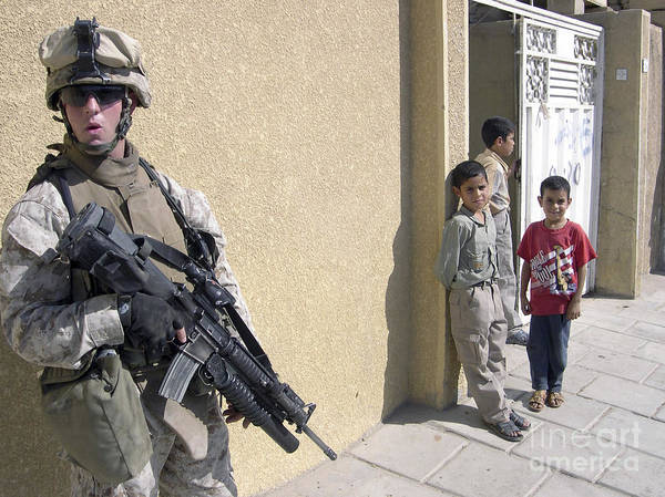 Grenade Launcher Wall Art - Photograph - A Group Of Iraqi Children Observe by Stocktrek Images