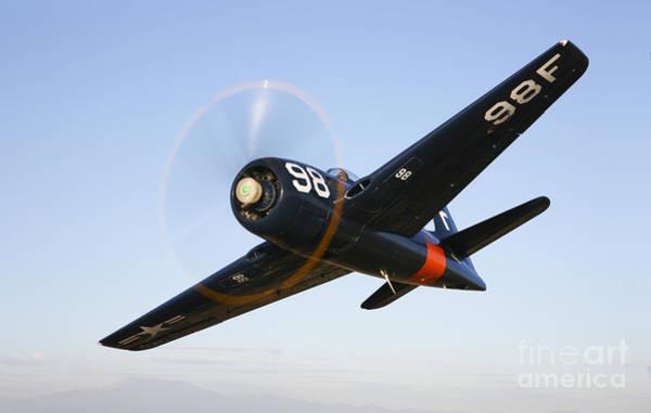 Photograph - A Grumman F8f Bearcat In Flight by Scott Germain