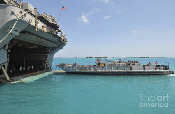 Amphibious Assault Ship Wall Art - Photograph - A Landing Craft Utility Approaches by Stocktrek Images