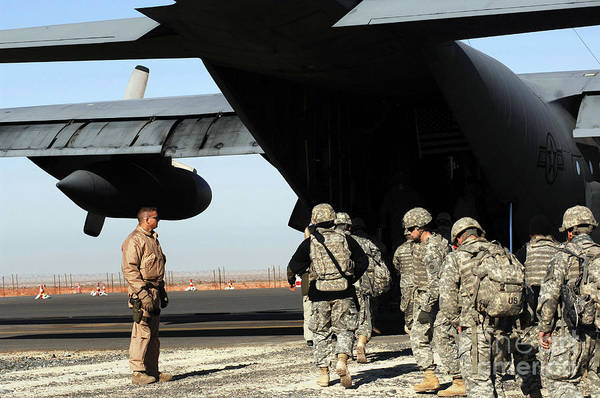 Airbase Photograph - A Loadmaster Guides Soldiers Onto by Stocktrek Images