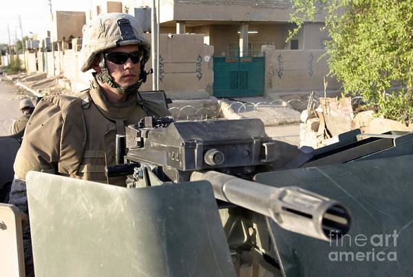 Grenade Launcher Wall Art - Photograph - A Machine Gunner Mans His Mk-19 by Stocktrek Images