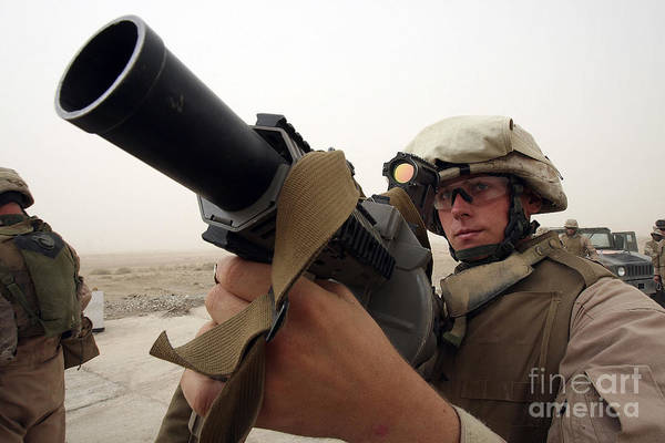 Grenade Launcher Wall Art - Photograph - A Marine Aims In With A M-32 Multiple by Stocktrek Images